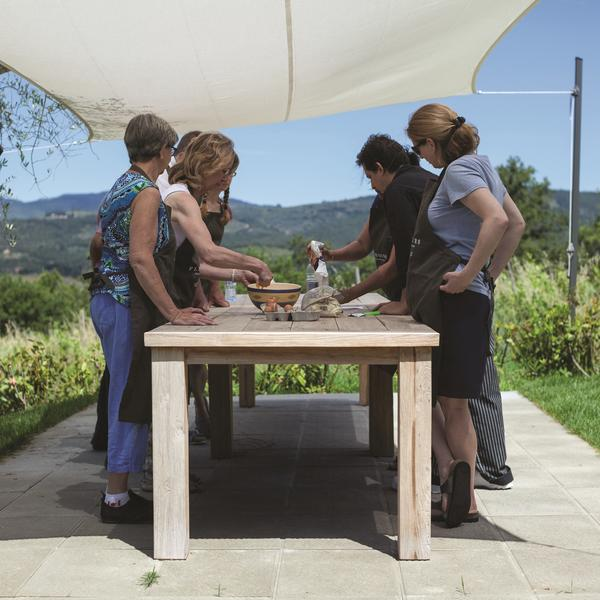 Guests preparing food outside on a Flavours Holidays trip