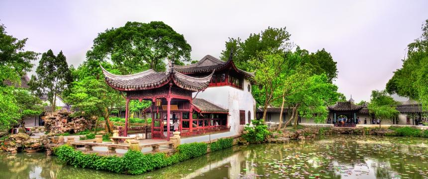 View over lily pond to one of the 12-century buildings in the Humble Administrator's Garden in Suzhou