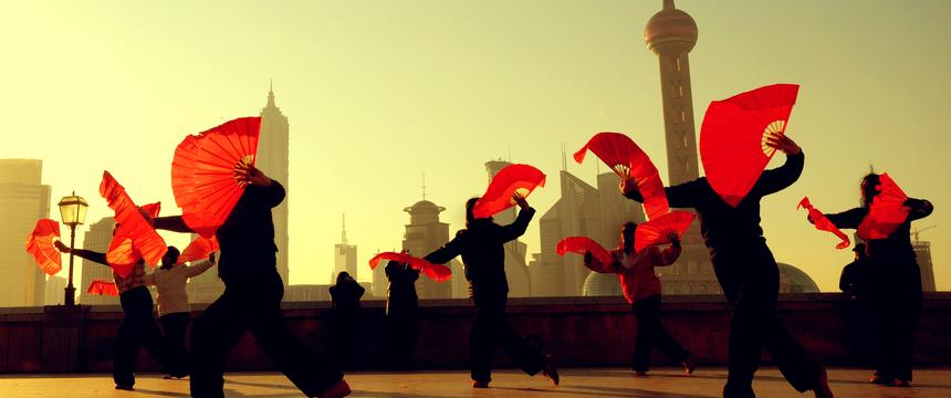 Silhouette of dancers in front of Shanghai skyline