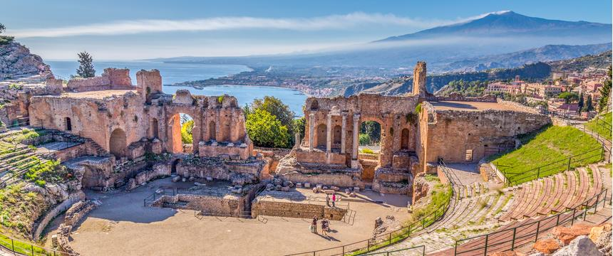 Sicilian town of Taormina, perched on the shoulder of Mount Etna