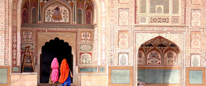 Two women in colourful saris walk in to the Amber Fort in Jaipur